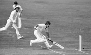 Derbyshire's Barry Wood and Geoff Miller (in sun hat) appeal as Allan Lamb of Northamptonshire fails to make his ground and is run out.