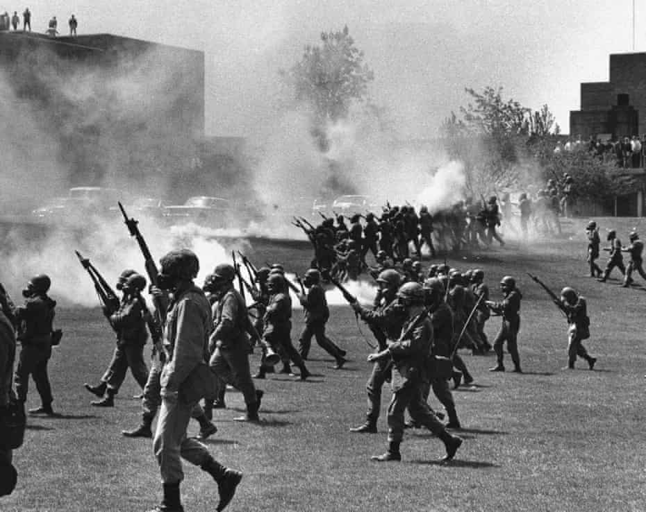 May 4, 1970 file photo, Ohio National Guard soldiers move in on war protesters at Kent State University in Kent, Ohio, on 4 May 1970.