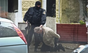 Moldova police arrest a man during a uranium-235 sting operation in 2011