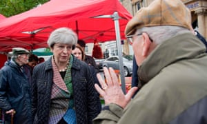 Theresa May speaking to a man during an election campaign walk about around Abingdon Market near Oxford this morning.