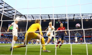 England's Steph Houghton makes a clearance under pressure from Caroline Hansen.