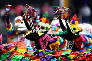 Day of the Dead entertainers perform before the Formula One Grand Prix of Mexico at Autodromo Hermanos Rodriguez in Mexico City, Mexico.
