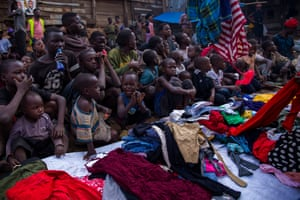 Street kids wait to receive free clothes from the street uncles in Kisenyi.