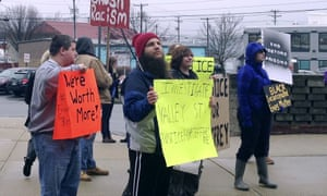 Activists and coworkers of Jeffery Pendleton protest outside the Hillsborough County's department of corrections on Friday in Manchester, New Hampshire.