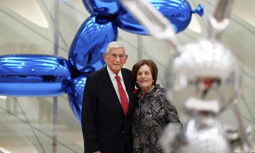 Eli Broad and Edye Broad with Jeff Koons sculptures at the Broad art museum in Los Angeles.