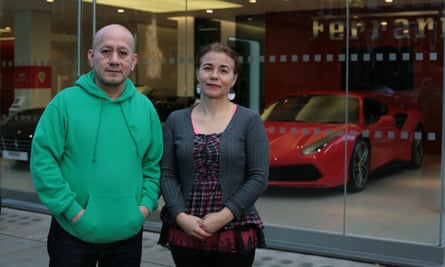 Freddy Lopez and Angelica Valencia Bolanos outside the Ferrari showroom in London they used to clean.