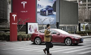 Electric cars, like this in Beijing, could become more common in the region