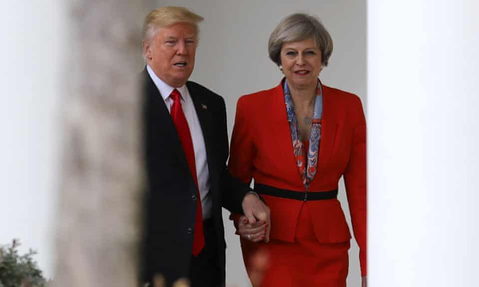 Donald Trump holds Theresa May's hand