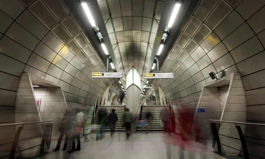 Long Exposure shot of people moving through Southwark Station