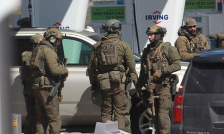 Canada shooting: armed police at the gas station near Halifax, Nova Scotia, where Gabriel Wortman was pronounced dead after a standoff on Sunday.