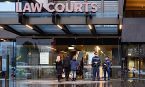 Police stand in front of Christchurch high court on Friday as the accused gunman of the mosque massacre faced friends and families of victims.