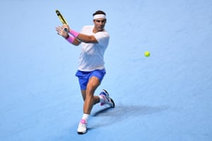 Nadal plays a backhand return.