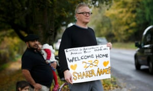A well-wisher holds a placard after the aircraft carrying Shaker Aamer landed at Biggin Hill airport near London. Aamer was known as Prisoner 239 at Guantánamo Bay.