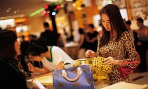 A woman shops at a Louis Vuitton shop in Shanghai.