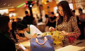 A woman shopping for handbags
