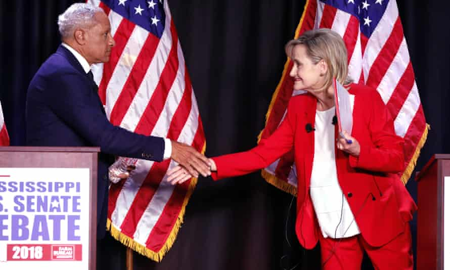 Democrat Mike Espy and Republican Cindy Hyde-Smith shake hands at a debate in Jackson, Mississippi on 20 November.