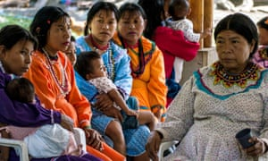 Women from Colombia's Emberá  indigenous group attend a UN education programme on the dangers of female genital mutilation