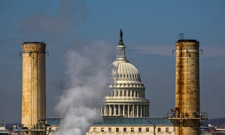 The dome of the US Capitol is seen behind the smokestacks of the Capitol Power Plant, the only fossil-fuel-burning power plant in the District of Columbia.