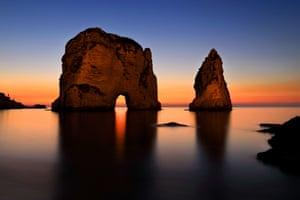 Beirut, Lebanon: The sun sets over the Mediterranean Sea and the Rawcheh Sea Rock
