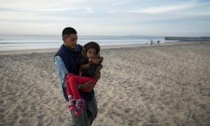Juan and Lesly on the beach near the fence in Tijuana, where Lesly saw the sea for the first time. She was very excited and couldn't stop looking at the ocean.