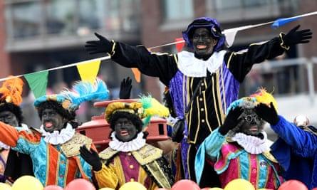 Zwarte Piet arrives by boat at the harbour of Scheveningen, Netherlands in November, 2019.