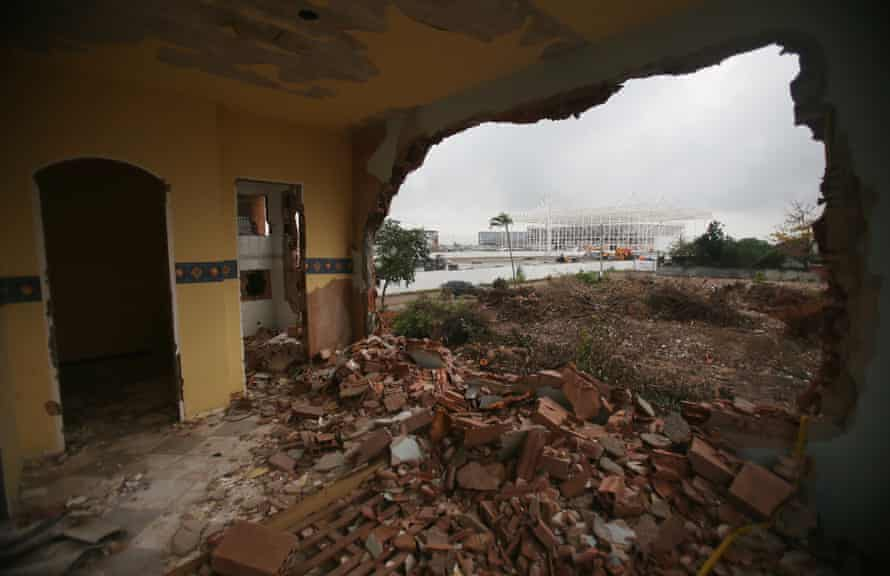 A partially demolished home in the Vila Autódromo favela, with the Olympic Aquatics Stadium under construction in the background.