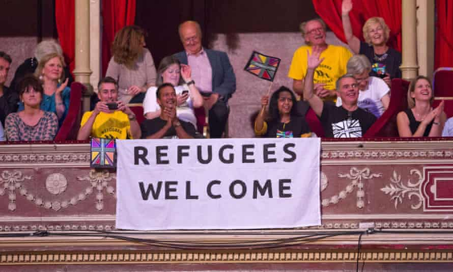 A sign reads 'Refugees Welcome' during the Last Night of the Proms at the Royal Albert Hall in west London.