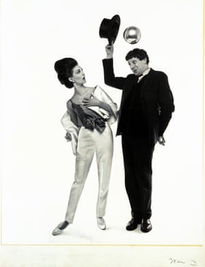 Photographed for Vogue in 1964, Miller tips his hat for a model, to reveal a silver ball