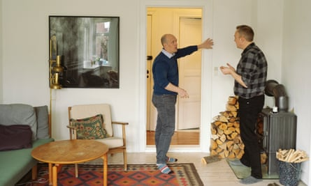 It's a jungle in there ... Rob Dunn (left) explores Lars Eriksen's home in Copenhagen. Photograph: Marie Hald/The Guardian