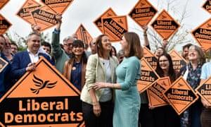 Brecon byelection winner Jane Dodds MP, centre left, and Lib Dem leader Jo Swinson MP celebrate her victory.