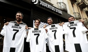 Juventus supporters with newly purchased Cristiano Ronaldo shirts in Turin.  The club s owners are only a163e4afe