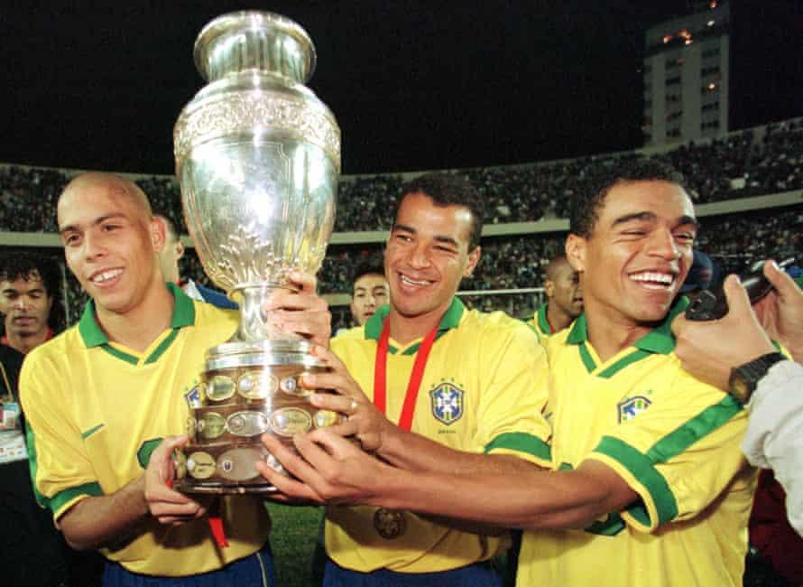 Ronaldo, Cafu and Denilson celebrate with the Copa América in 1997.