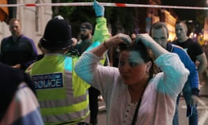 Police lead people away from London Bridge after attackers drove a van into pedestrians before continuing on to Borough Market and stabbing a number of people