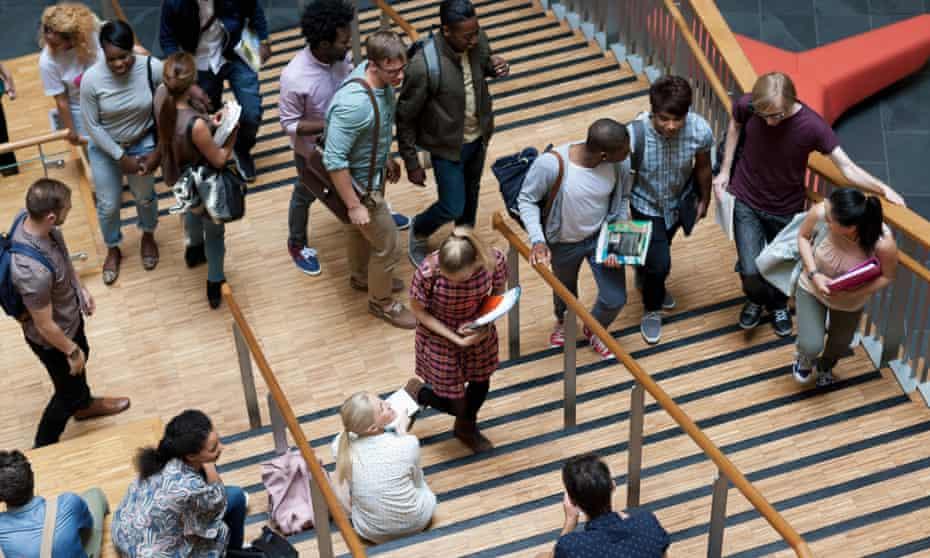 University students walking up some steps