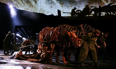 Actors work with life-sized puppets by the Handspring Puppet company in War Horse.