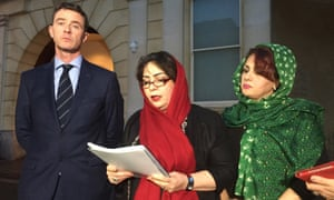 Bijan Ebrahimi's sisters Manizhah Moores (centre) and Ladin Ebrahimi with their solicitor Tony Murphy outside court