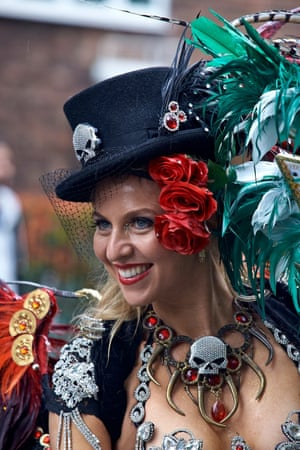 """<strong>Raining Voodoo!</strong><br>Lady in full costume - downpour!<br>Photograph: <a href=""""https://witness.theguardian.com/assignment/55deeea5e4b0778f0c23e764/1689554"""">bob2000/GuardianWitness</a>"""