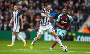 West Brom's Gareth Barry takes control of possession against West Ham.