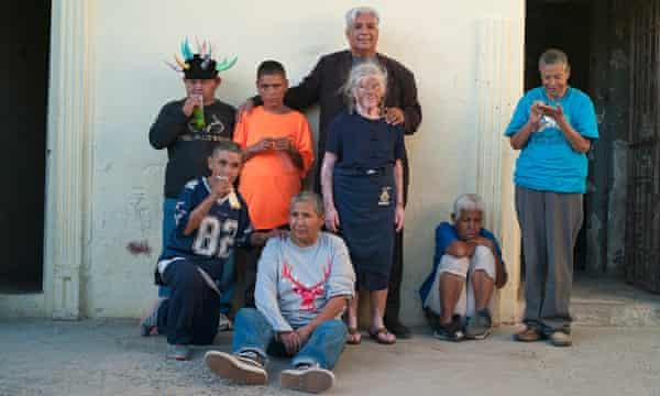 Pastor José Antonio Galván, who runs the Visión En Acción asylum outside Juárez, with residents (Yogi in the jester's hat): 'I was one of them,' he says.