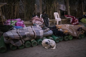 People sleep on top of empty oxygen cylinders waiting for a shop to open in order to refill their tanks in the neighbourhood of Villa El Salvador.