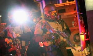 Police confront protestors after riioting broke out in Ferguson
