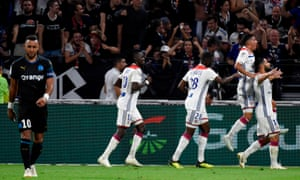 Nabil Fékir celebrates with his teammates after scoring Lyon's final goal in their 4-2 win over Marseille.