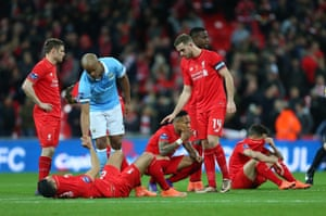 February 28, 2016: Kompany consoles dejected Liverpool players after a penalty shootout to win the League Cup final 3-1 after a final score of 1-1.