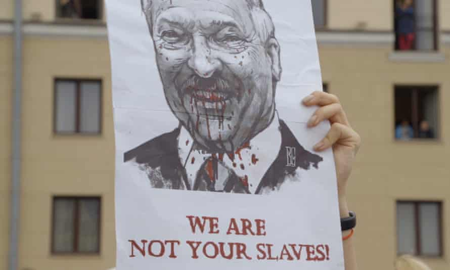 Protesters in Minsk, holding up an image of President Lukashenko.