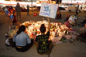 People pay tribute to those who died at a memorial on the Las Vegas strip