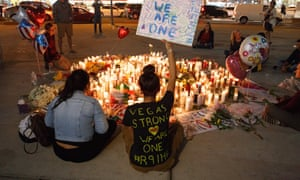 Mourners pay tribute at a makeshift memorial on the Las Vegas Strip