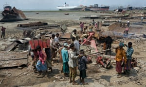 Shipbreakers cut up a beached vessel for scrap in Chittagong, Bangladesh.