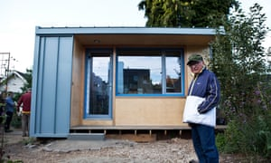 In late September, homeless man Robert Desjarlais stands outside the nearly completed 125ft modern cabin that he will live in.