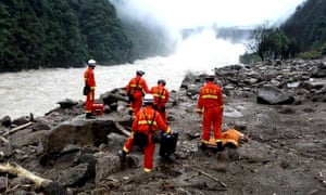 Rescuers search for potential survivors at the site following a landslide in southeast China.