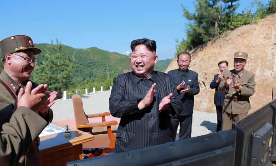 North Korean leader Kim Jong-un celebrates the test-fire of a ballistic missile.